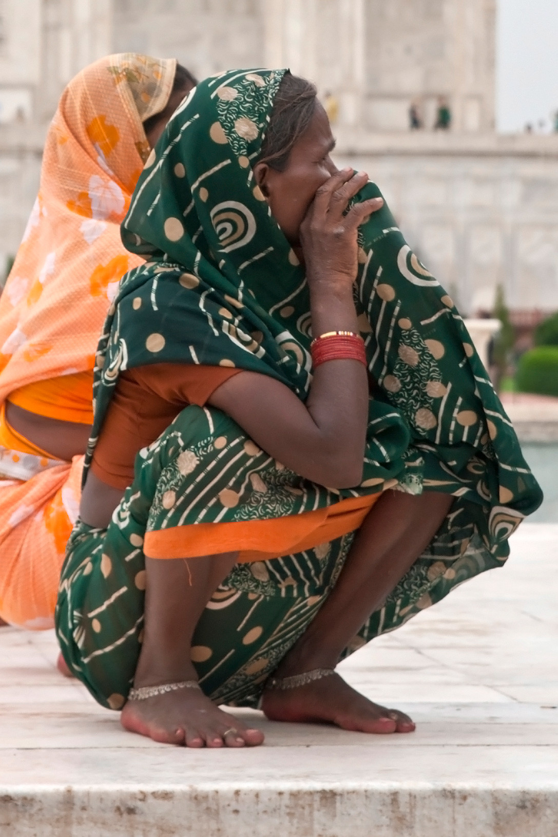 An Indian woman resting in a natural flat-footed deep squat