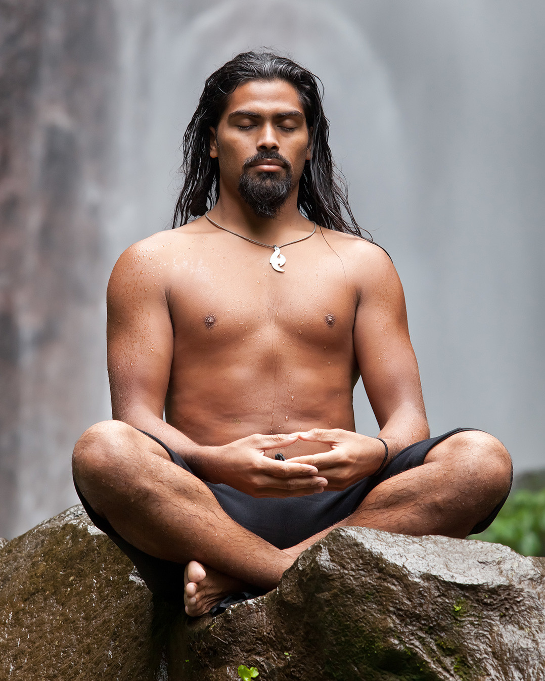 A young man meditating in nature