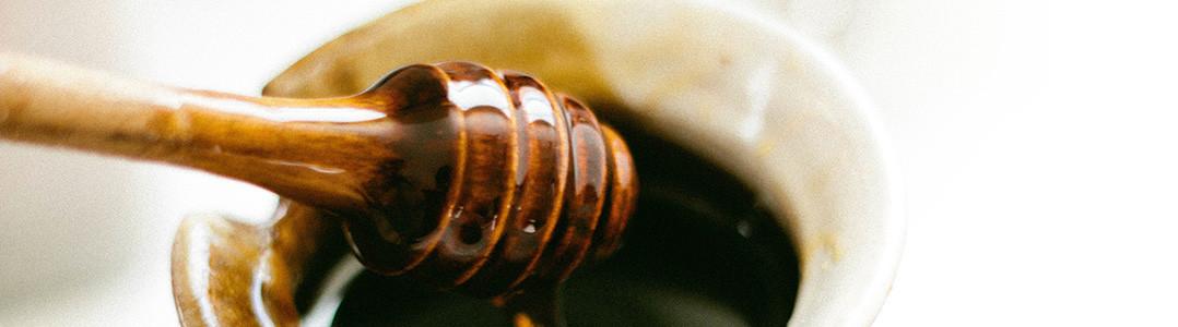 A cup of rich-dark honey