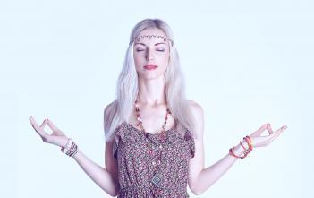 A young classy bohemian woman meditating.