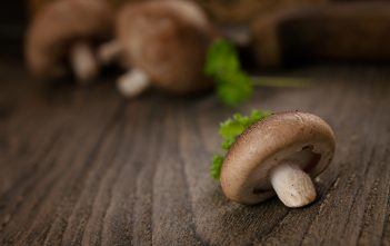 Shiitake mushrooms on a wooden table.