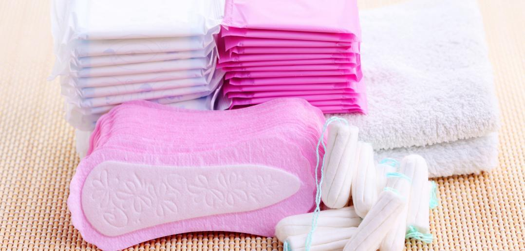 stacks of menstrual pads and tampons