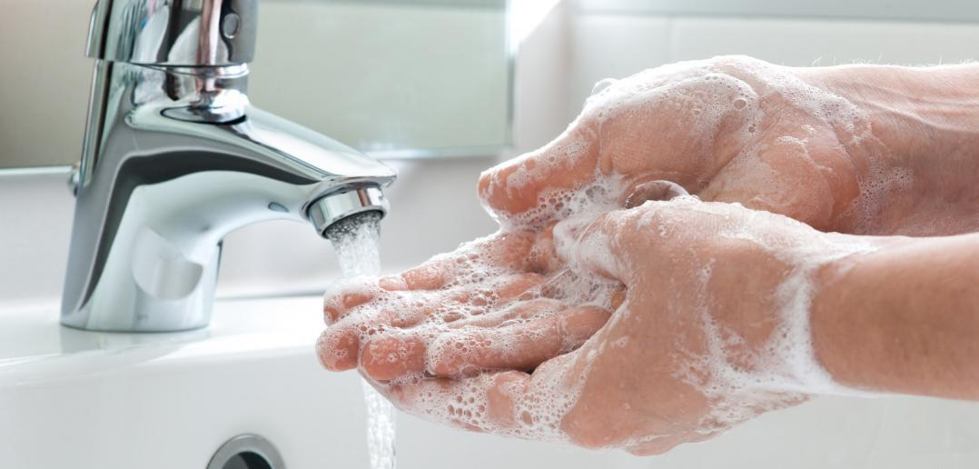 creating greywater by washing hands with soap