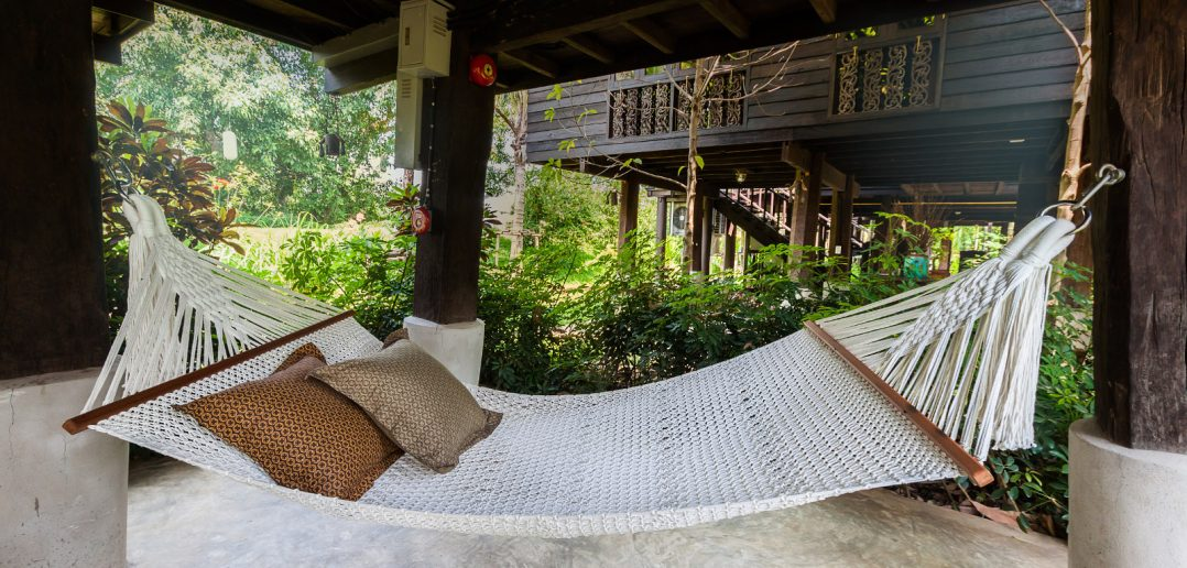 hammock with pillows hung in room
