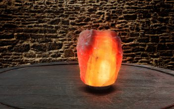 himalayan salt lamp lit and sitting on a table