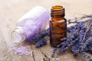 vial of lavender oil with lavender flowers