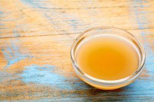apple cider vinegar in bowl with mother