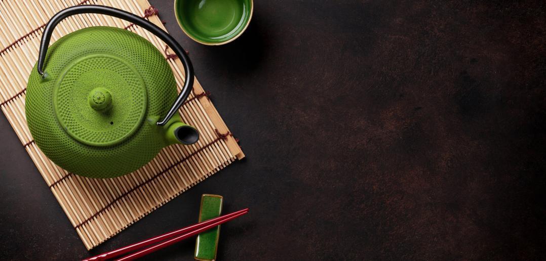 Japanese green tea in green pot.
