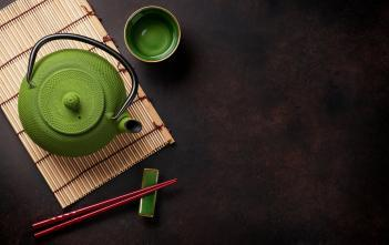Japanese green tea in green pot.