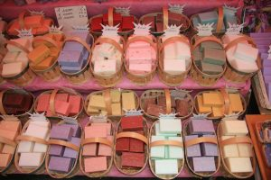 Assorted bars of soap in baskets on a market in the Provence, France
